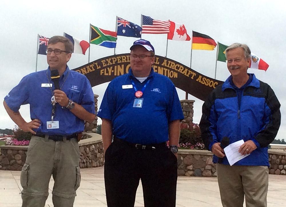 Charlie Becker (far left) announces his pick for Homebuilt Community volunteer of the year.