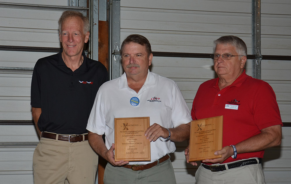 """From left to right: Mike Meyers of Wills Wings, representing the SETP; Bob Pastusek of LOBO and William """"Jeff"""" Edwards, President of LOBO. Edwards and Pastusek were presented with Spirit of Flight Awards at this year's AirVenture Technical Counselor and Flight Advisor breakfast. Photo courtesy of EAA."""