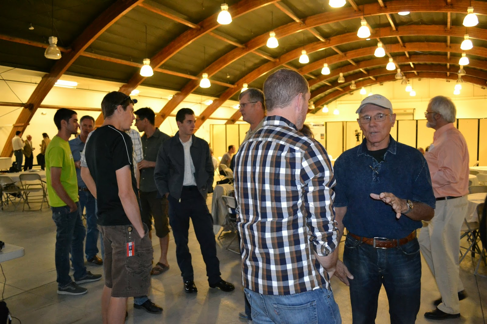 MEFI is still small, informal, and the highest concentration of brainy airplane geeks I've run into. At least half of the people in this picture are engineers or test pilots. Astronaut Mike Melvill, on the far right facing the camera, gave a fascinating speech covering the major Scaled Composites projects he worked on during his 32 years as a test pilot for Burt Rutan. Photo: Jenny Carreon.