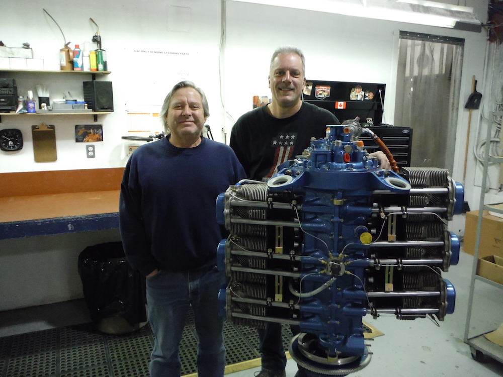 Dwain Harris (L) Harmon Rocket builder and Rob Horvath, Master Engine Builder with the 2,100th engine assembled by Aero Sport Power.