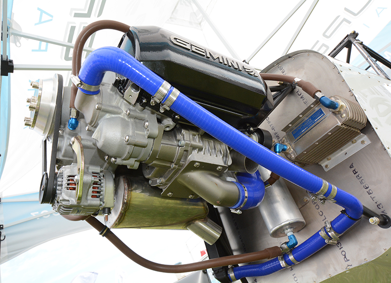 As a 2-stroke diesel the Gemini uses a small rootes-type blower to scavenge (not supercharge) the cylinders. The compact alternator and large muffler are also visible.
