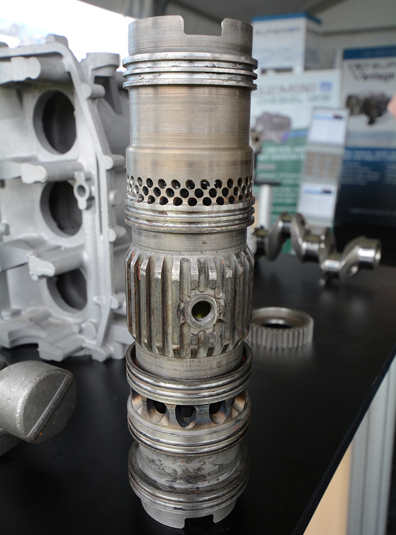 Looking rather involved is a Gemini cylinder. Intake and exhaust ports are shared through the cylinder walls by two opposing pistons. Hardly a new concept, Jumo used this exact layout very successfully during WWII.