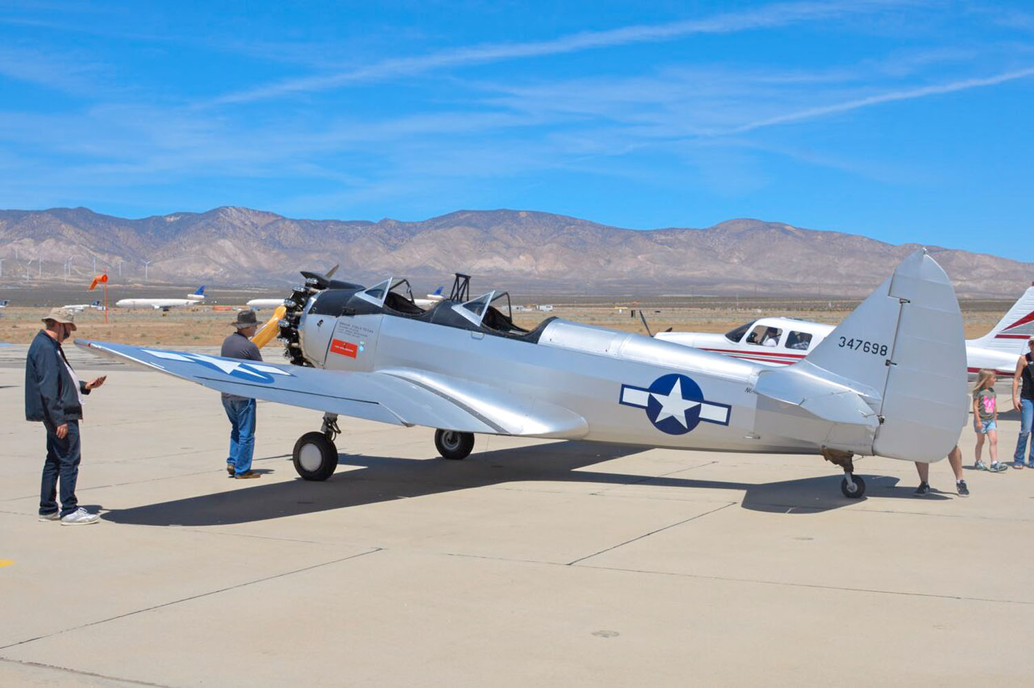 A lot of people were wondering just which WWII primary trainer this was. It's a PT-23 owned by Todd Schultz. A Fairchild product, the PT-23 employed the ubiquitous 220 hp Continental radial. Imagine getting your first instruction in an open cockpit?