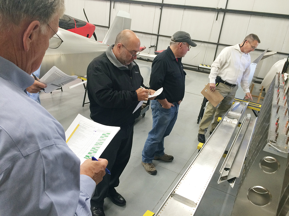 NKET members and trainees work with Sonex staff to evaluate the fabrication and assembly tasks required to build Sonex and Waiex B-Model wing panels.