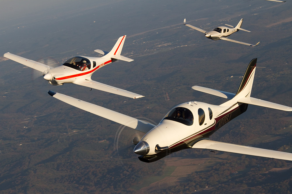 Lancairs in flight with the Evolution in the lead, followed by a Legacy and a IV-P. There is no doubt that these are fast and fine-looking airplanes. Photo by Steve Schulte courtesy of LOBO.