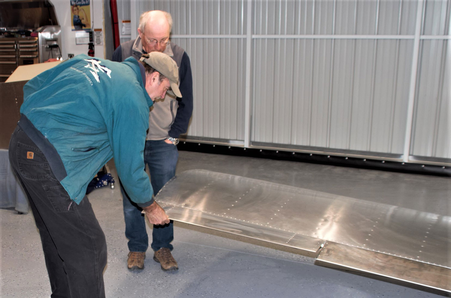 John Stahr (left) and Paul Dye discuss how to handle painting the ailerons.
