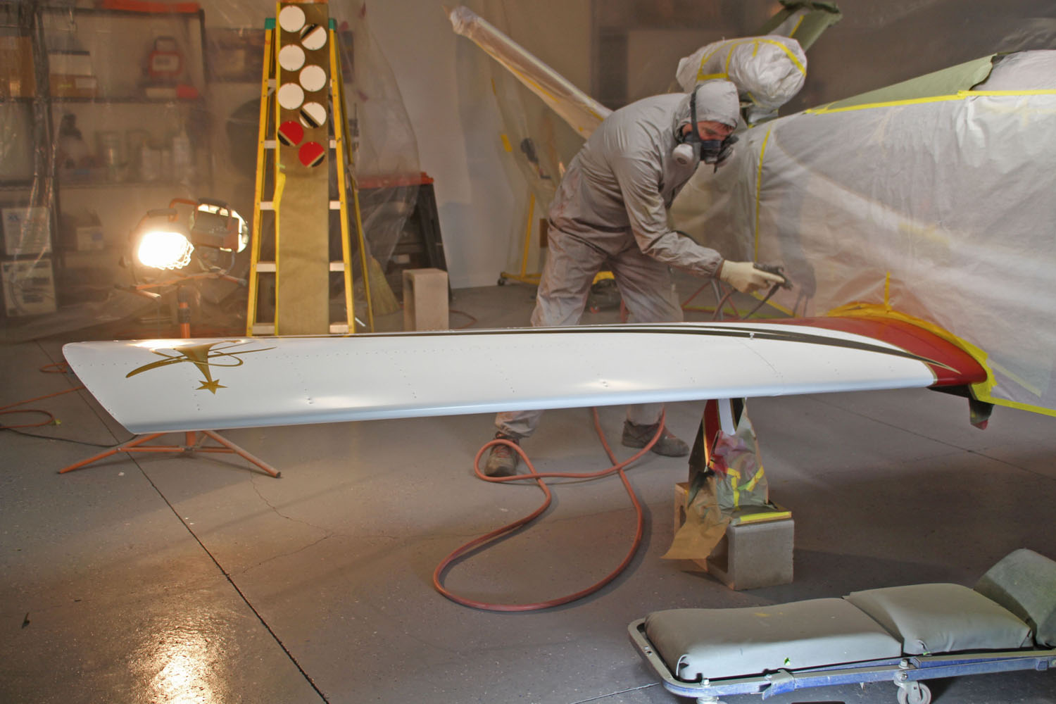 The clear coat process began with spraying inspection plates hanging on a board and then coating the wings.
