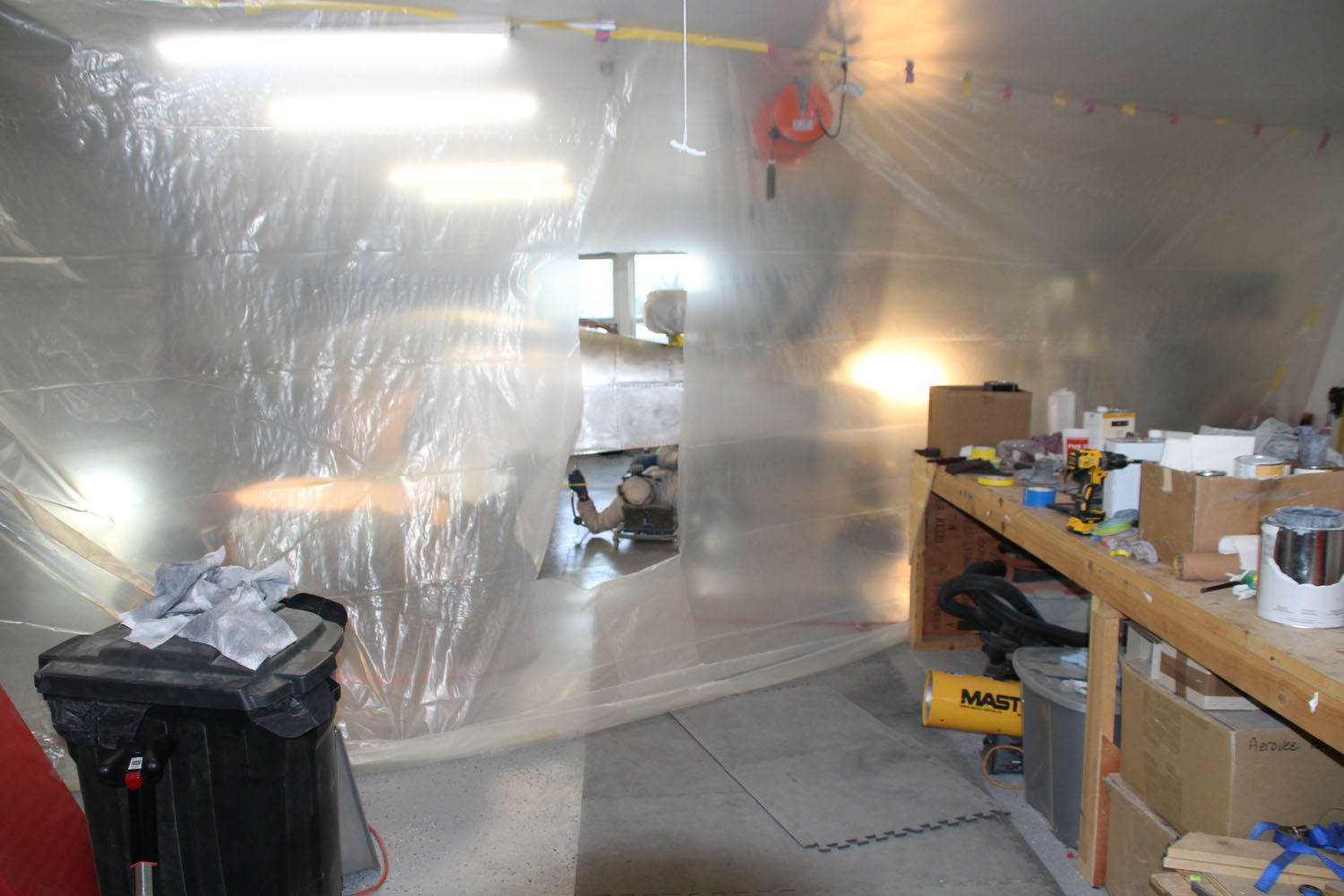 Paint booth installed, it was time to prime. Note the propane heater (yellow cylinder in lower right) heating the air before it is drawn through the paint booth.