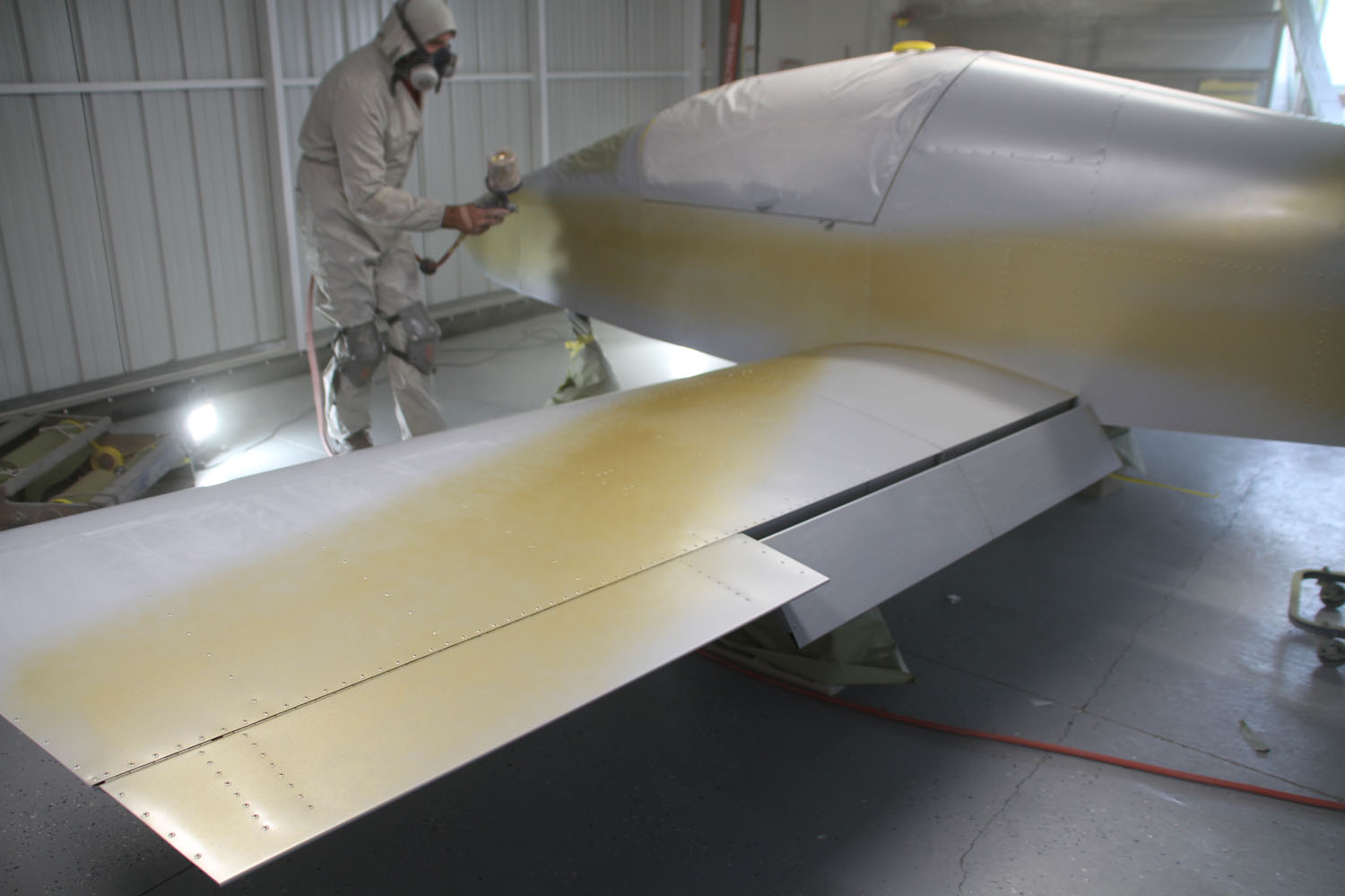 After lightly sanding the primer, Stahr applies the gold pin striping free-hand. Unlike some airplane painters, Stahr likes to start with an