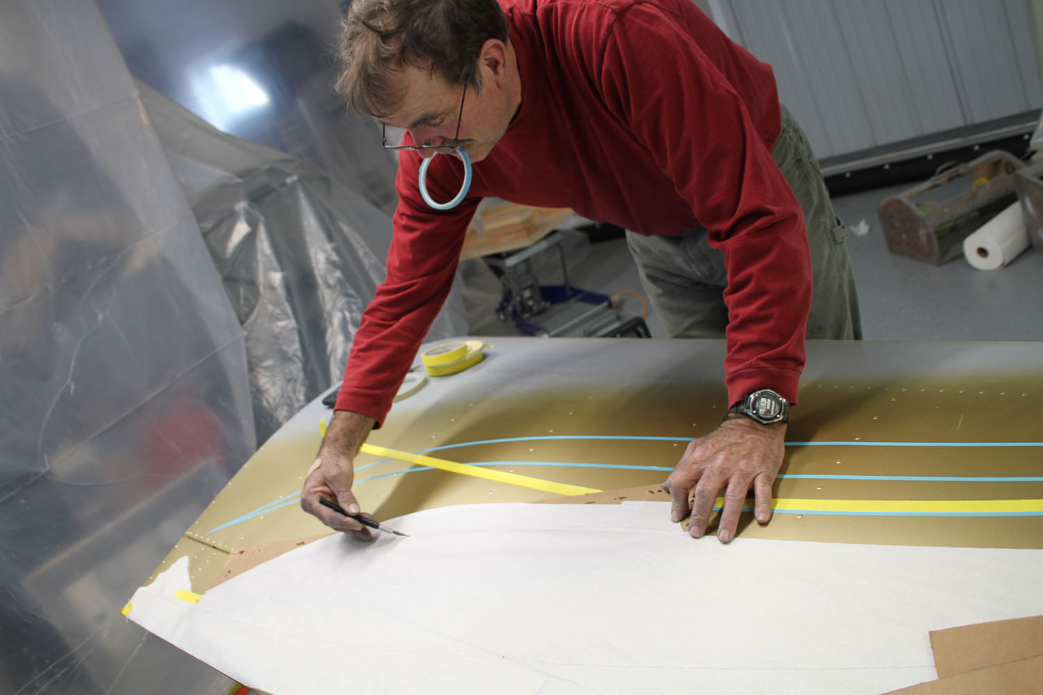 Paper patterns of the first completed side are made with an Exact-O knife tracing the tape lines.