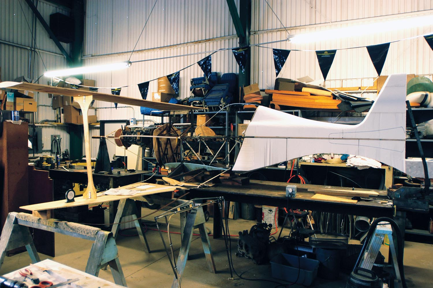 Part airplane, part mock-up is how Phantom began on the Aberle Custom Aircraft welding bench. Plywood added to the Mong Sport fuselage visualized the completed racer; eventually the plywood was replaced by carbon fiber structures.