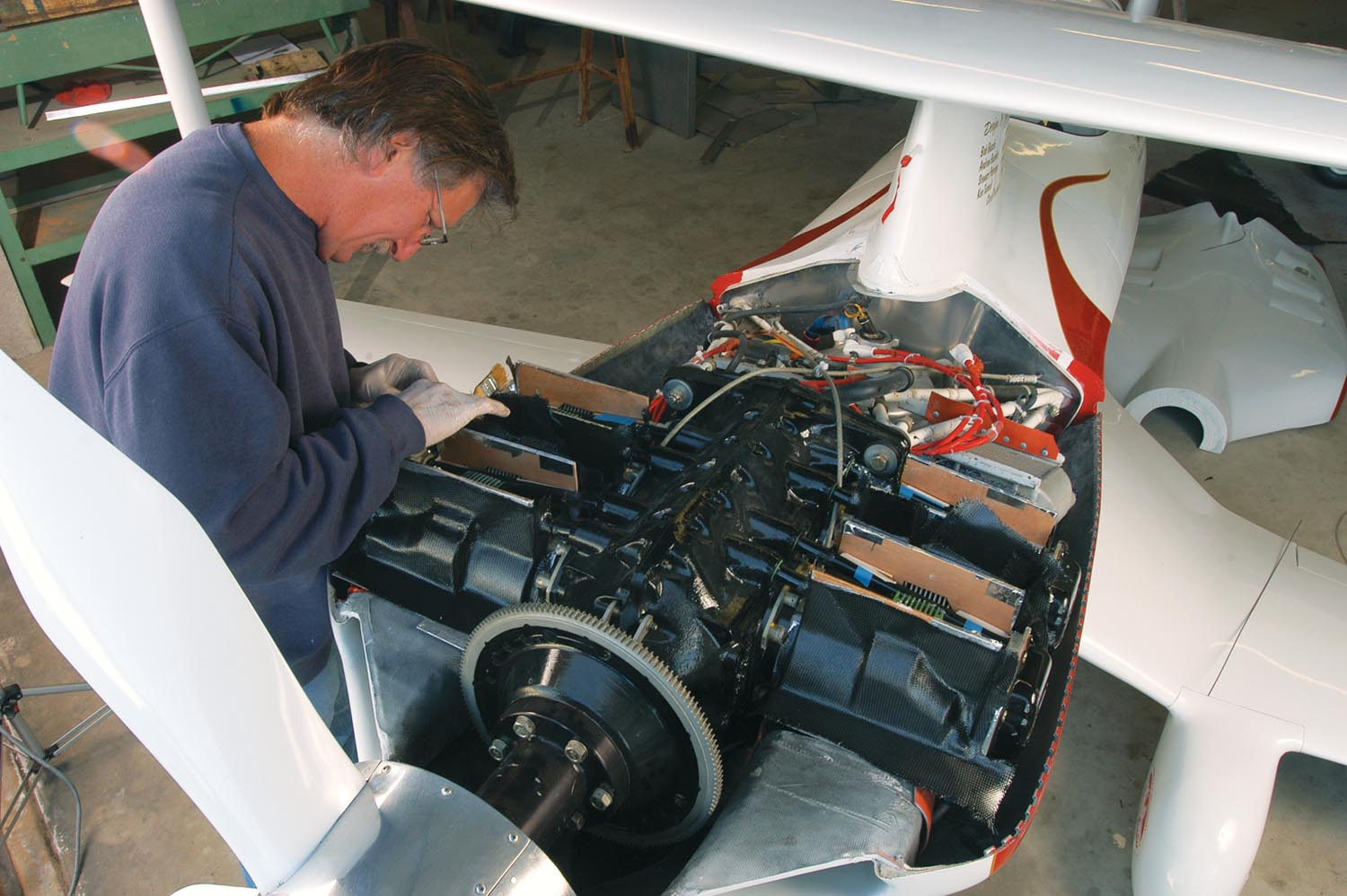 Phantom's first cylinder exit air baffles were horrid tape-and-aluminum rush jobs. Later Andy built these proper carbon fiber baffles. Engine cooling has never been an issue with the updraft cooling system, an idea Tom Aberle took from Bill Falck's Rivets F1 racer.