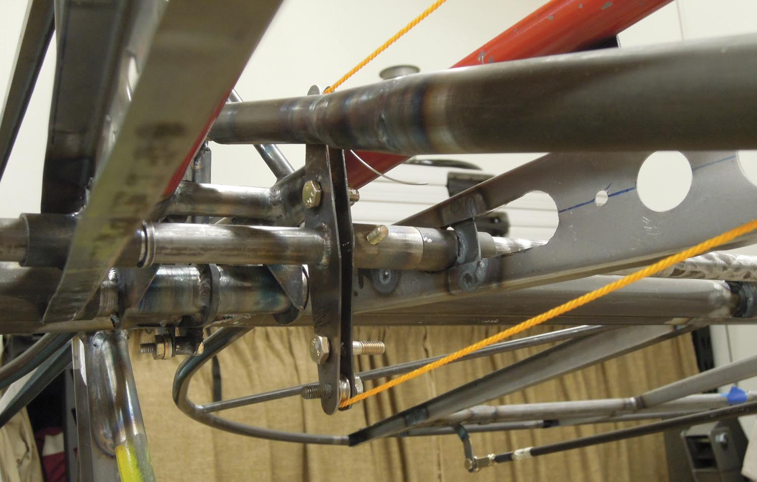 The trim tab bellcrank and elevator pushrod barely miss each other as they move through their necessary arcs.