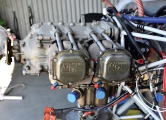 The Superior IO-360 engine stripped and ready for cylinder removal. Note that oil return lines are capped as are the intake tubes in the sump. Until the decision has been made to completely tear down the engine it is best to protect everything as you go.