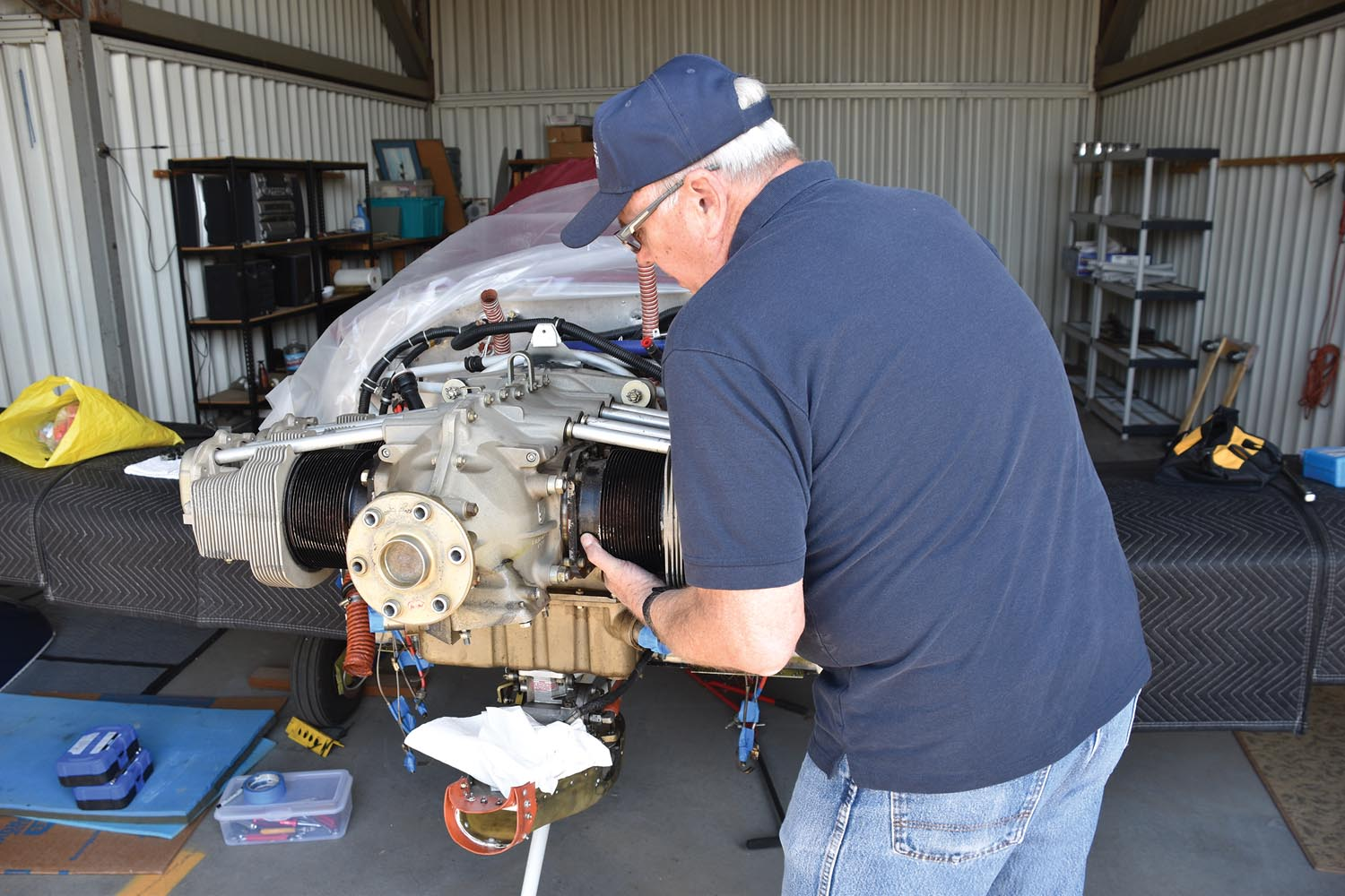 Owner Bill Palmer removes a cylinder after first determining that there was significant rust in the cylinder with a borescope examination. This recently acquired RV-6A was bought with full knowledge that there were problems with the engine and was priced accordingly.